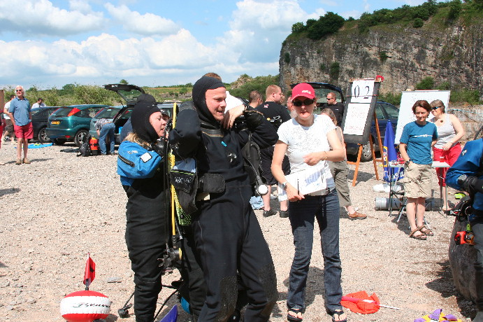 Sally and Terry - come on, heave! Mandy doing dive logs, and Mary keeping an overview on her organisation!