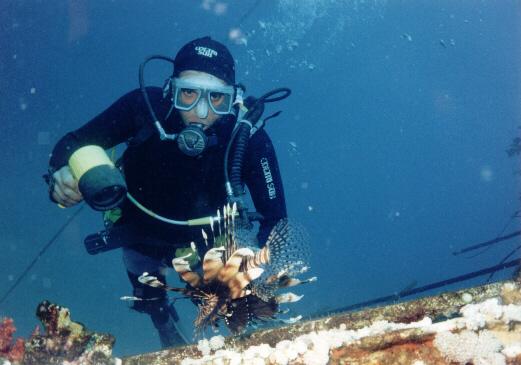 A Diver with a poisonous Lion Fish.